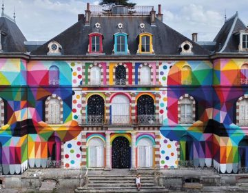 Colorful skulls on an old french chateau