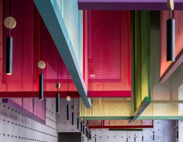 Colorful hanging screens play with the space in Telaviv