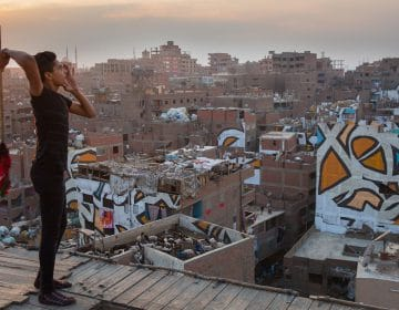 eL Seed paints a stunning massive mural in Cairo
