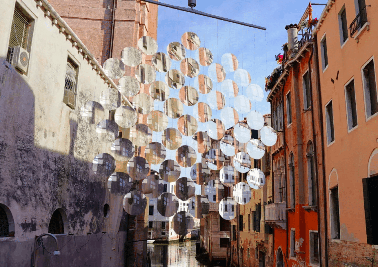 Vincent Leroy imagines giant mobile of magnifying glass floating above venetian boats